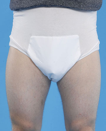 Washable pant with integral pad