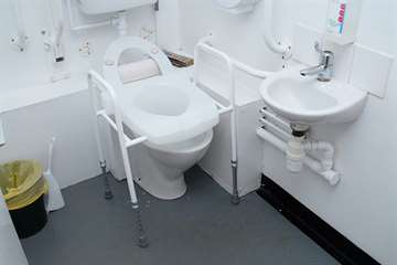 Toilet frame with raised seat